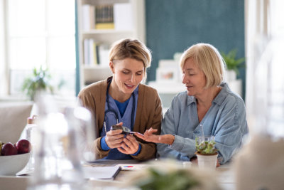 Nurse, caregiver or healthcare worker with senior woman patient