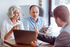 senior couple consulting with insurance agent