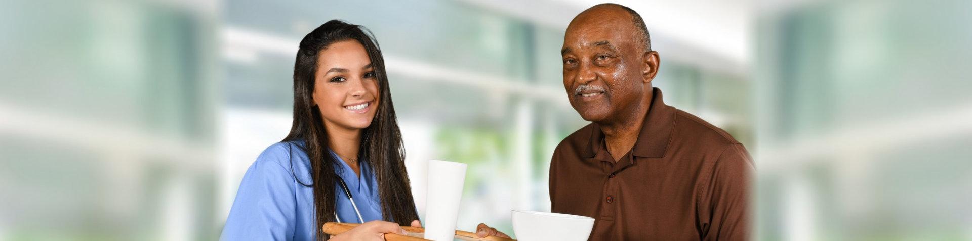 caretaker and old man smiling