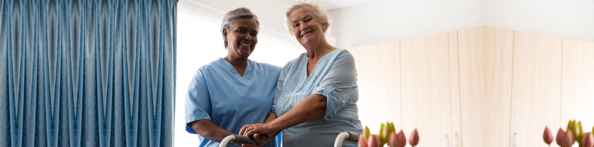 caretaker and woman smiling